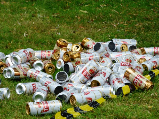 Discarded cans on the grass.