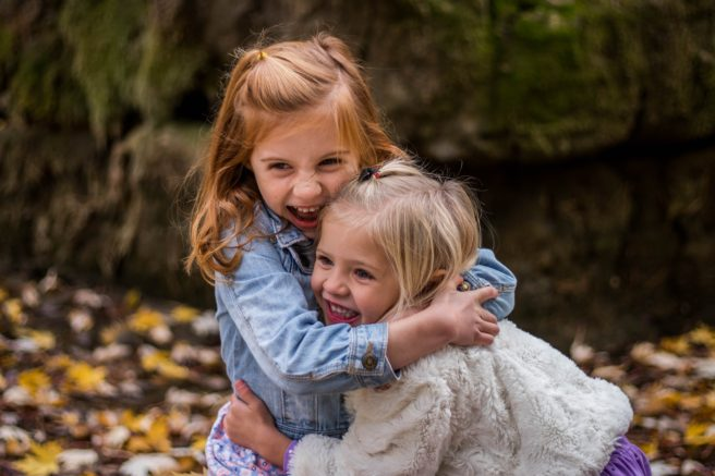 Two girls hugging.
