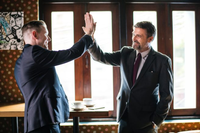 A lawyer giving a high five to a client.